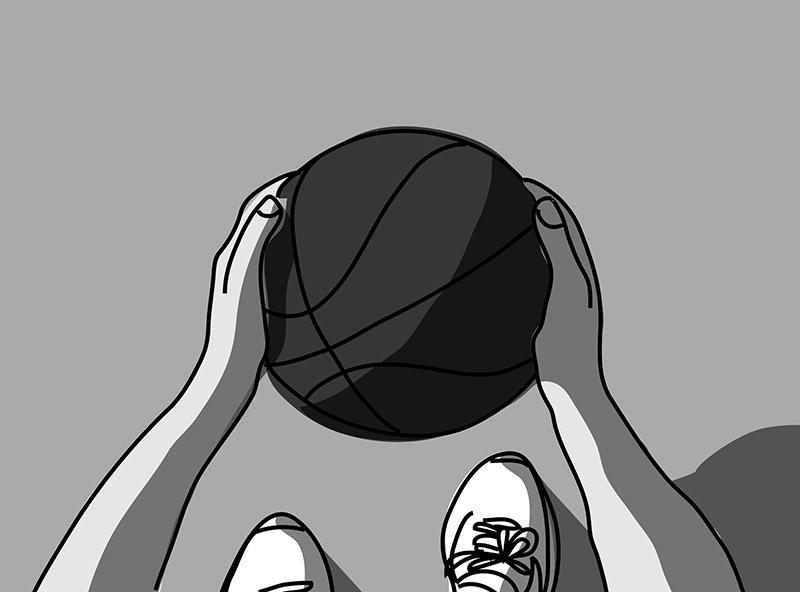 バスケットボールを持つ